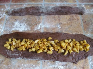 "Roll it into an oblong shape about 30cm/ 12"" long and fill with apples. Do this 4 times"